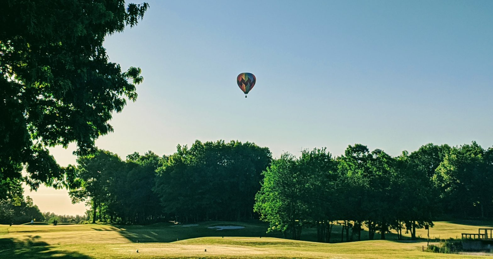 hot air balloon over golf course